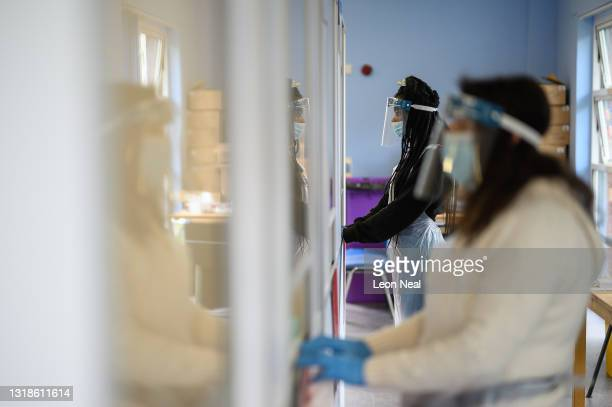 Members of the testing team wait for people to arrive for swab tests at the Faraday Community Centre asymptomatic COVID-19 test centre on May 18,...