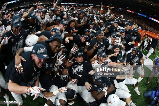 Members of the Texas Longhorns celebrate after defeating the Georgia Bulldogs 2821 during the Allstate Sugar Bowl at MercedesBenz Superdome on...