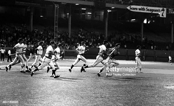 Members of the Texas Rangers run onto the field after drunken fans run onto during a game against the Cleveland Indians on June 4 1974 at Cleveland...