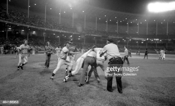 Members of the Texas Rangers take down a drunken fan who ran onto the field during a game against the Cleveland Indians on June 4 1974 at Cleveland...