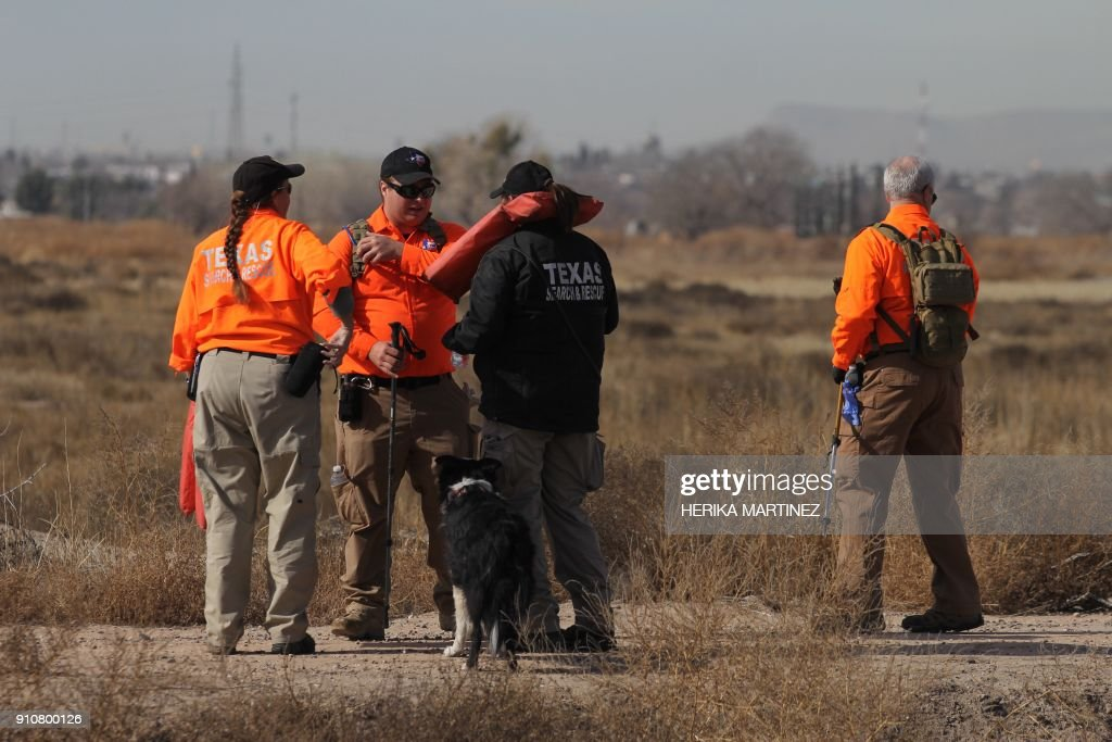 members of the texas search and rescue team accompanied by dogs and