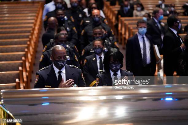 Members of the Texas Southern University Police Department pause at the casket bearing the remains of George Floyd in the chapel during his funeral...