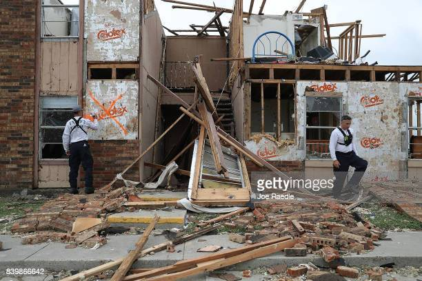 Members of the Texas Task Force 2 search and rescue team work through a destroyed apartment complex trying to find anyone that still may be in the...
