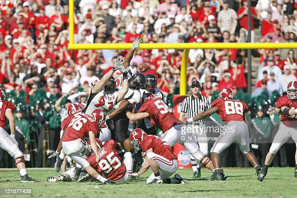 Members of the Texas Tech Red Raiders leap up to block a field goal attempt during the first half against the Alabama Crimson Tide at the AT & T...