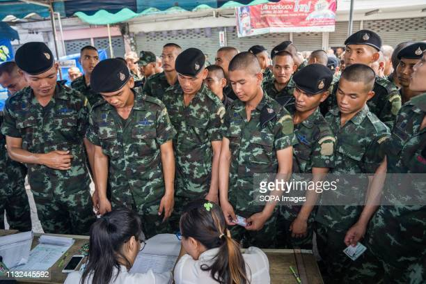 Members of the Thai military registering at a polling station before casting their ballots Thailand is hosting its first General Election in 8 years...