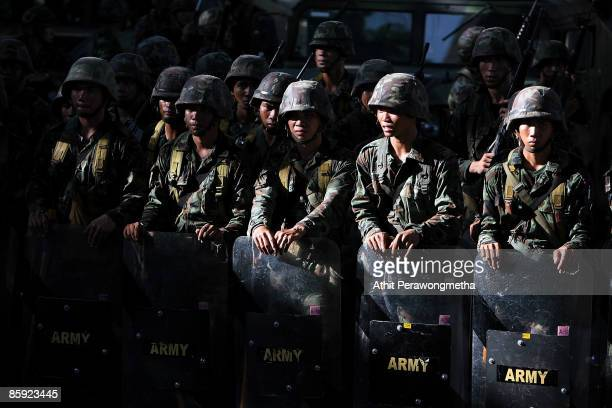 Members of the Thai military take position as they try to clear supporters of former Prime Minister Thaksin Shinawatra during a protest on April 13...