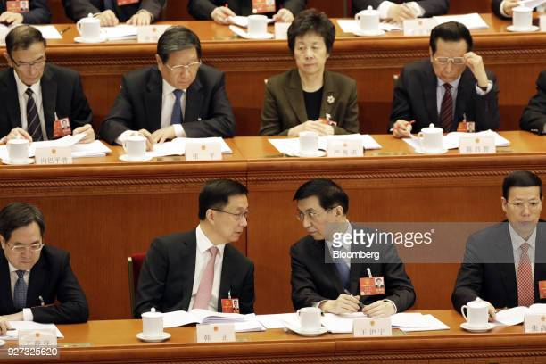 Members of the the Communist Party of China's Politburo Standing Committee Han Zheng front row second left speaks with Wang Huning front row second...