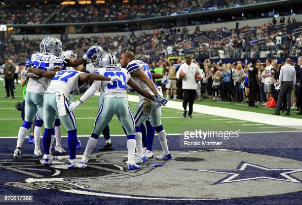Members of the the Dallas Cowboys defense huddle before a game against the Kansas City Chiefs at ATT Stadium on November 5 2017 in Arlington Texas