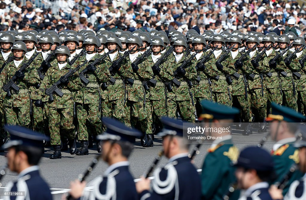 Members of the the Japan Ground Self-Defense Force march during the annual review at the Japan Ground Self-Defense Force Camp Asaka on October 23, 2016 in Asaka, Japan.