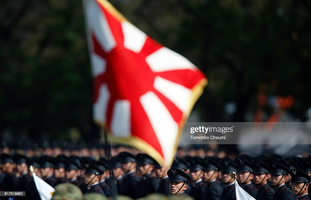 Members of the the Japan Maritime Self-Defense Force attend the annual review at the Japan Ground Self-Defense Force Camp Asaka on October 23, 2016 in Asaka, Japan.