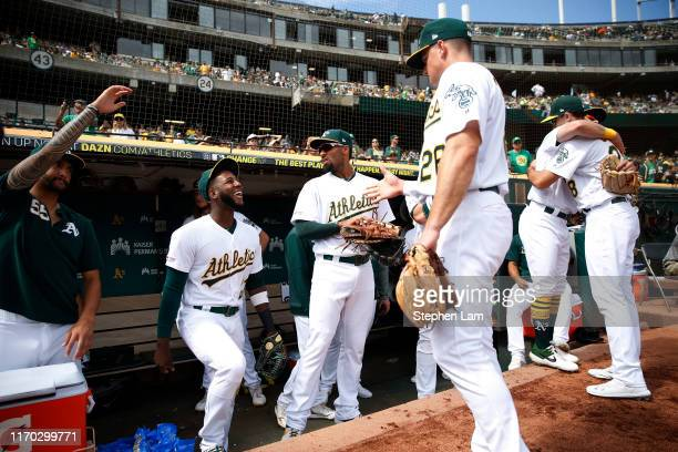 Members of the the Oakland Athletics are seen in the dugout before their game against the Texas Rangers at Ring Central Coliseum on September 22 2019...