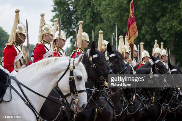 Members of the The Queen's Life Guard and the Blues and Royals change the guard during the daily ceremonial in Horse Guards Parade, on 11th June...