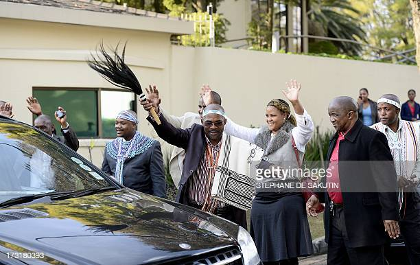 Members of the Thembu royal house greet the car of Thembu King Buyelekhaya Dalindyebo leaving the house of former South African President Nelson...