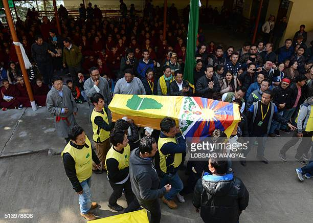 Members of the Tibetan Youth Congress carry the coffin bearing the body of Dorje Tsering during his funeral in the Indian town of McLeod Ganj on...
