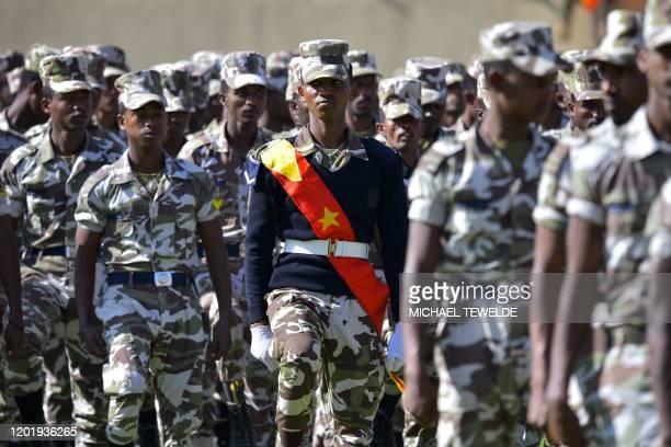 """Members of the Tigray region special police force parade during celebrations marking the 45th anniversary of the launching of the """"Armed Struggle of..."""
