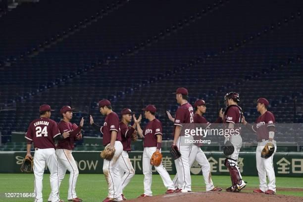Members of the Tohoku Rakuten Golden Eagles celebrate following a Nippon Professional Baseball preseason baseball game against the Yomiuri Giants...