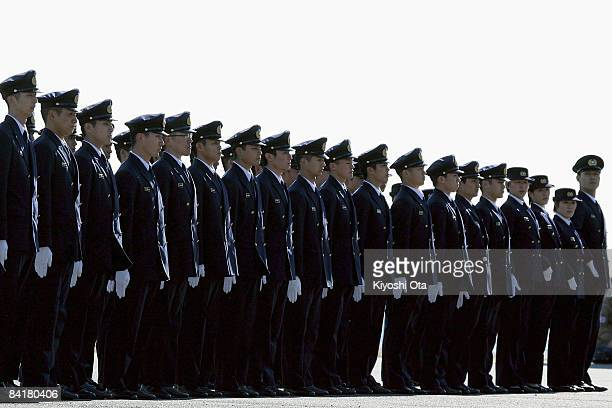 Members of the Tokyo Fire Department perform company footdrills during the New Year's fire review conducted by the Tokyo Fire Department at Tokyo Big...