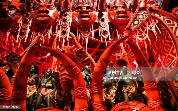 Members of the Tom Maior Samba School perform on top of a float during the parade at Anhembi Sambadrome of Sao Paulo on February 21 2020 in Sao Paulo...