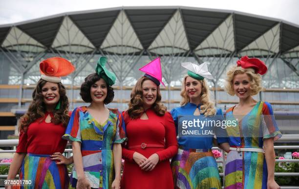 Members of The Tootsie Rollers jazz band pose for a photograph as they arrive on day one of the Royal Ascot horse racing meet in Ascot west of London...