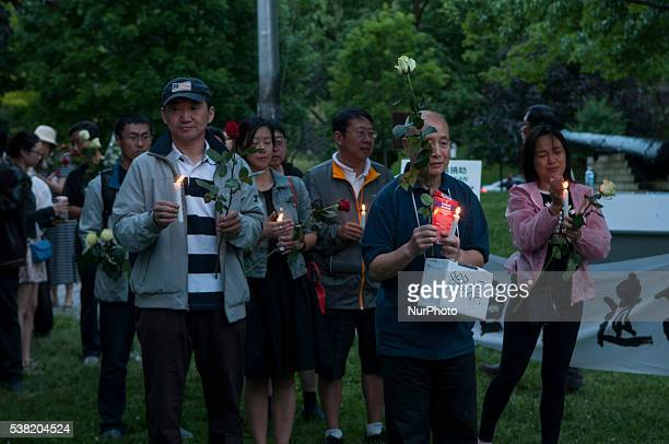 Members of the Toronto Association for Democracy in China, lights the candle in front of the Chinese embassy 4 June 2016 to commemorate the 27th...