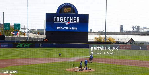 Members of the Toronto Blue Jays ground crew prepare Sahlen Field for the final game of the MLB regular season for the Toronto Blue Jays against the...