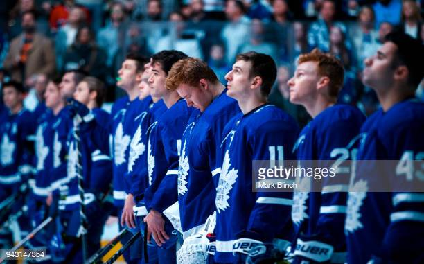 Members of the Toronto Maple Leafs stand for a moment of silence to remember the victims of the a bus accident which claimed the lives of 15 people...