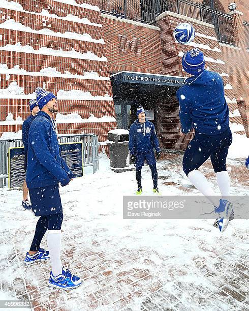 Members of the Toronto Maple Leafs warmup with a soccer ball outside before the Bridgestone NHL Winter Classic against the Detroit Red Wings on...
