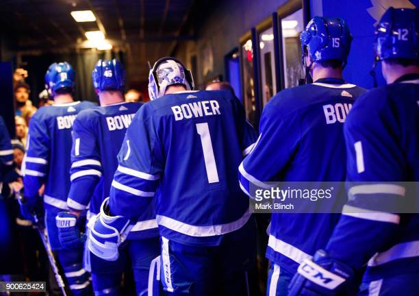 Members of the Toronto Maple Leafs wear jersey's honouring Leafs legend Johnny Bower as they head to the ice for warmup at the Air Canada Centre on...