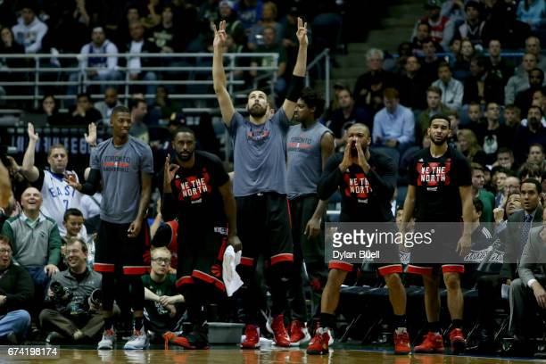 Members of the Toronto Raptors bench celebrate in the third quarter against the Milwaukee Bucks in Game Six of the Eastern Conference Quarterfinals...