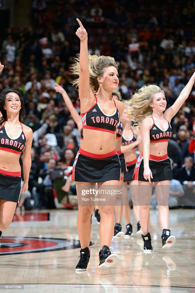 Members of the Toronto Raptors Dance Team gets the crowd pumped up against the Boston Celtics during the game on February 6, 2013 at the Air Canada Centre in Toronto, Ontario, Canada.