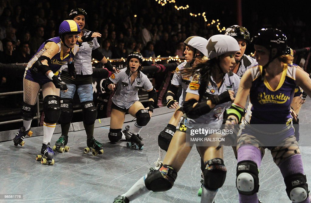 Members of the Tough Cookies team (blue uniforms) compete against the Varsity Brawlers (purple uniforms) during the L.A. Derby Dolls women's banked track roller derby event in Los Angeles on April 17, 2010. Roller Derby is a contact sport that originated in America and is based on two teams formation roller skating around an oval track, with points scored as one player known as a jammer laps members of the opposing team. The sport which began in 1922 is played predominantly by women skaters with a strong emphasis on punk aesthetics, unique costumes and humorous stage names. AFP PHOTO/Mark RALSTON