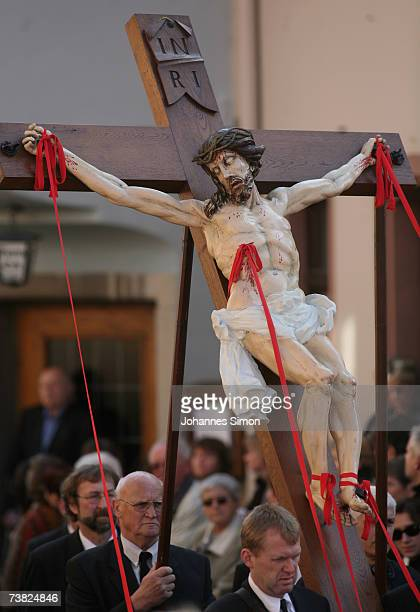 Members of the town's crafts guilds carry a likeness of Jesus Christ on the cross during a Good Friday procession on April 6 in Lohr am Main,...