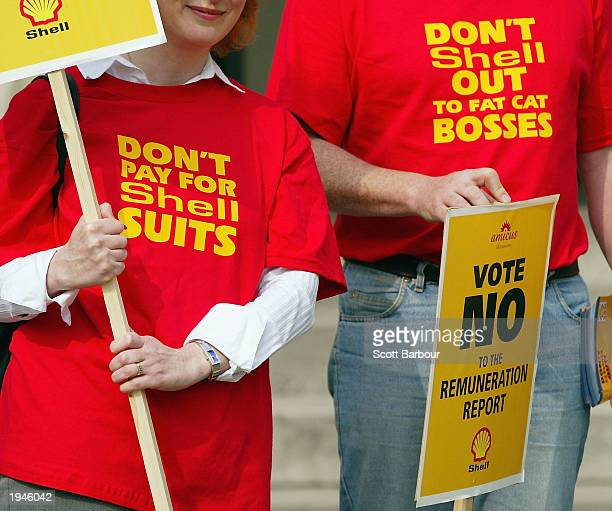 Members of the trade union Amicus hold placards during a demonstration outside Shell's Annual General Meeting April 23 2003 in London England Shell...