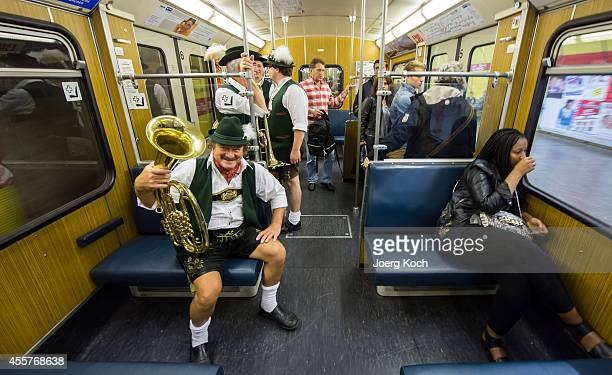 Members of the traditional bavarian marching band 'OktoberfestKapelle Karl Flauger' go to Oktoberfest 2014 by underground on September 20 2014 in...