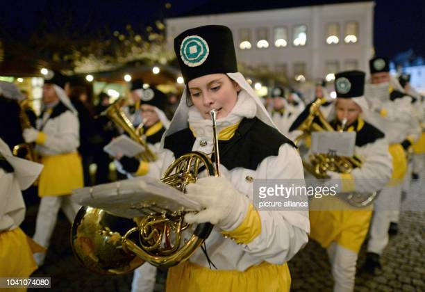 Members of the traditional brass band from Oederan perform with five more music bands and more than 500 participants in tradition costumes in a...