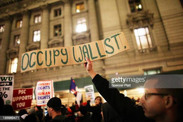 "Members of the Transportation Union Local 100 and supporters from ""Occupy Wall Street"" participate in a protest before marching to Zuccotti Park to..."