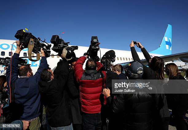 Members of the traveling press surround Democratic presidential nominee former Secretary of State Hillary Clinton before she boards her campaign...