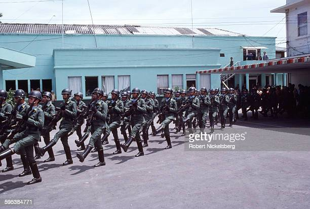 Members of the Treasury Police march in formation inside their main garrison San Salvador El Salvador July 1 1982 The Treasury Police were a wing of...