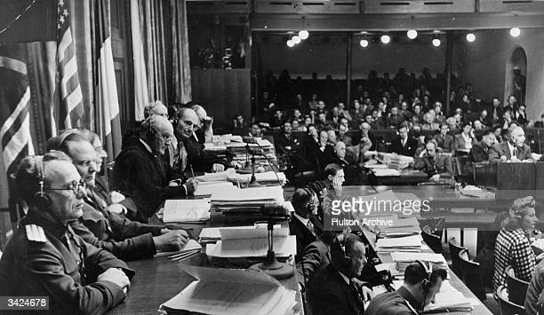 Members of the Tribunal , preside over the Nuremberg war crimes Trials. From left to right are : Colonel A F Volchlov , General J T Nikitchenko ,...