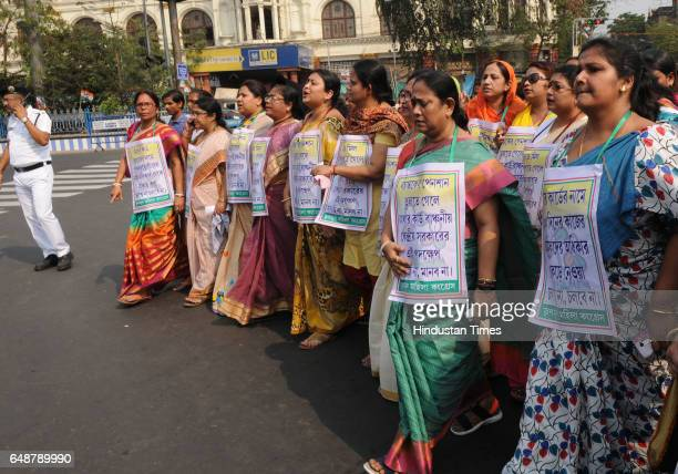 Members of the Trinamool Congress women's wing protest against the Centre's decision to make Aadhaar card compulsory for staff who prepare midday...