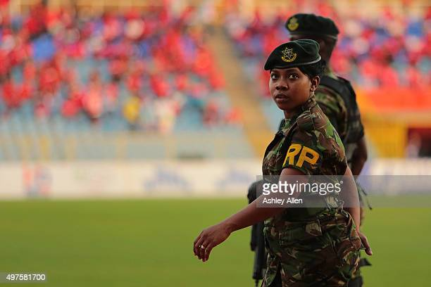 Members of the Trinidad and Tobago defence force patrol the pitch during a World Cup Qualifier between Trinidad and Tobago and USA as part of the...