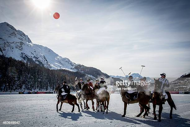 Members of the 'Trois Pommes' team battle for the ball with team 'BMW' during the Snow Polo World Cup 2015 on February 1 2015 in St Moritz Switzerland