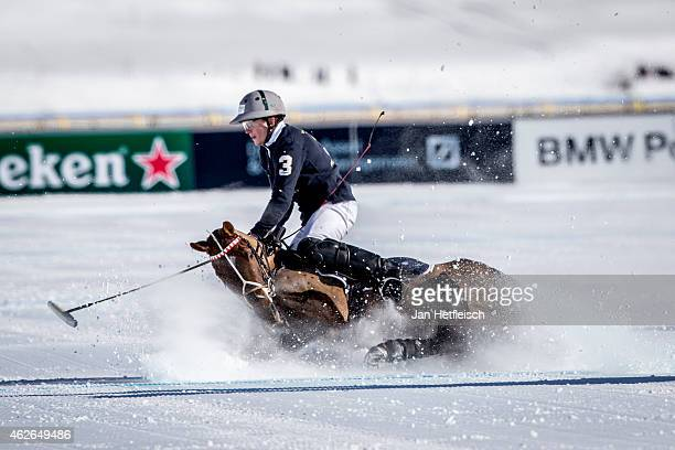 Members of the 'Trois Pommes' team battle for the ball with team 'Badrutts Palace Hotel' during the Snow Polo World Cup 2015 on February 01 2015 in...