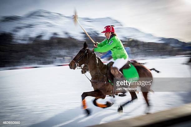 A members of the 'Trois Pommes' team battles for the ball with team 'BMW' during the Snow Polo World Cup 2015 on January 31 2015 in St Moritz...