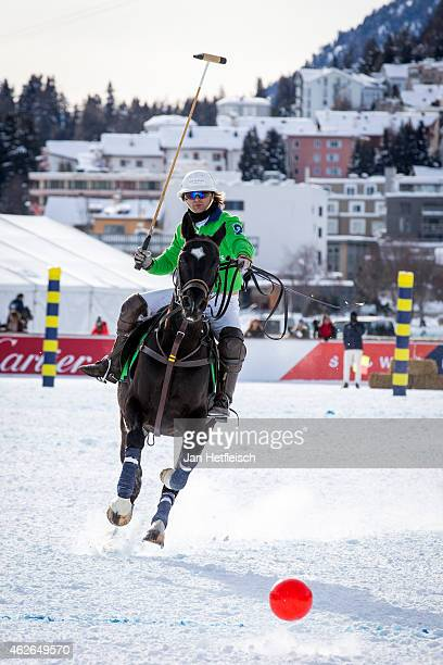 A members of the 'Trois Pommes' team tries to hit the ball during the Snow Polo World Cup 2015 on January 31 2015 in St Moritz Switzerland