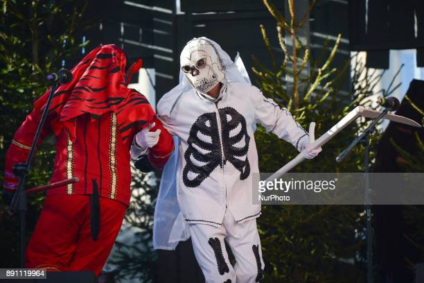 Members of the troupe of traditional Polish Christmas Carolers from 'Malopolska' Region dresses as Devil and Death perfom in Krakow's Main Square On...