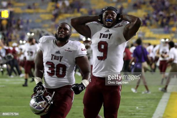 Members of the Troy Trojans celebrate after defeating the LSU Tigers 2421 at Tiger Stadium on September 30 2017 in Baton Rouge Louisiana