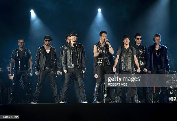 Members of the two boy bands New Kids on the Block and Backstreet Boys perform during their NKOTBSB Tour concert at Ahoy palace in Rotterdam on May 1...