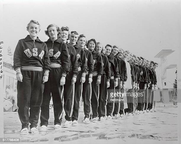 Members of the U S Olympic swimming and diving teams are shown lined up beside the Olympic Pool at Helsinki Left to right are Carol Frick of the...