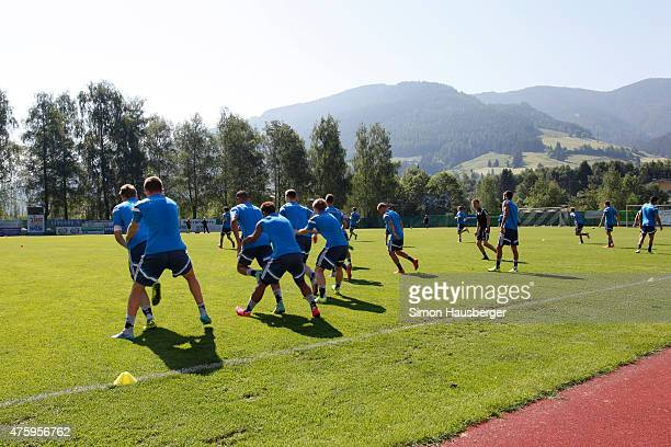 Members of the U21 German National team warmup during a training session on June 5 2015 in Leogang Austria